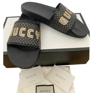 Gucci Black & Gold GUCCY Print Slides