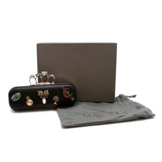 Alexander McQueen embellished black leather four-ring clutch bag