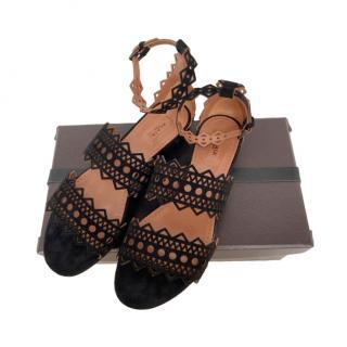 Alaia black laser cut suede platform sandals