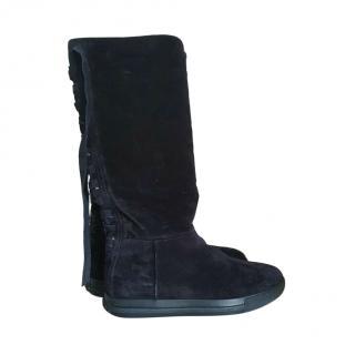 Miu Miu black shearling/sheepskin knee high boots.