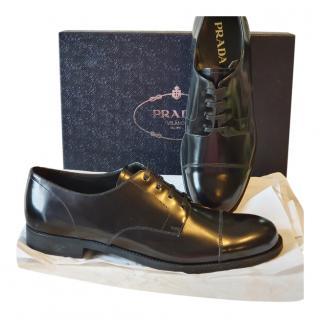 Prada black leather brogues