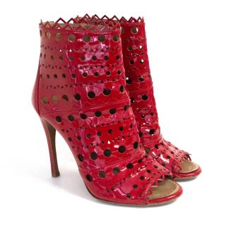 Alaia red patent cutout ankle boots