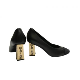 Chanel Black Cap-Toe Leather Pumps with Gold Hieroglyphic Heels