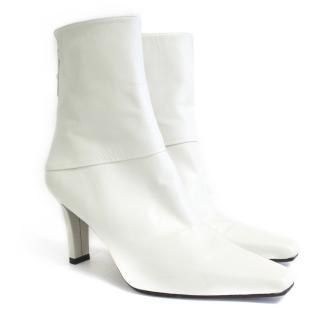 Stuart Weitzman white pointy toe ankle boots
