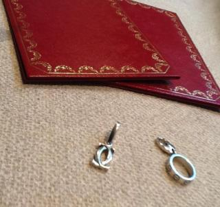 Cartier 18k white gold charms