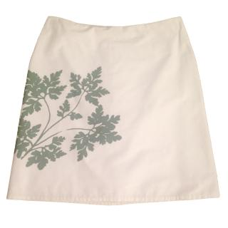 AGNES B white cotton knee length skirt w green floral print