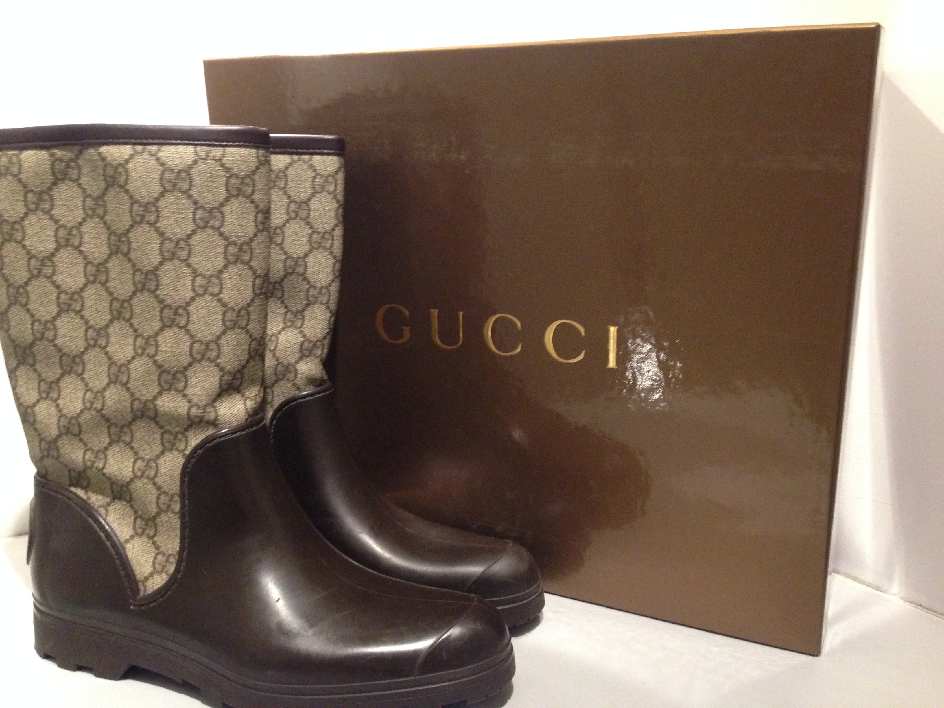 f070ab58f Gucci brown gg plus prato rubber boots. 26. 12345678