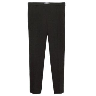 Chloe black wool cigarette trousers.