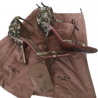 Alaia Embellished Python Heels