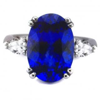 Tanzanite 6.25 carats flawless with diamonds in white gold