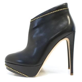 Rupert Saunderson black boots