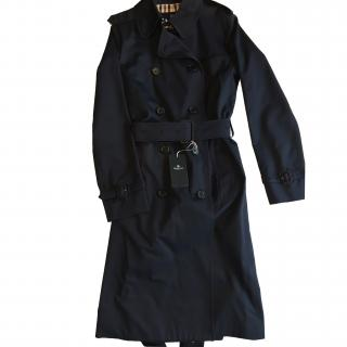 Aquascutum navy raincoat with Club check lining