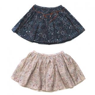 Two pairs of mosaic print skirts