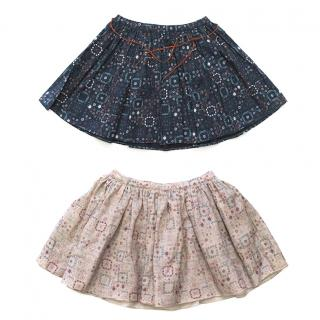 Two pairs of mosaic print skirts