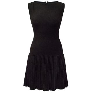 Alaia black dress with pleated skirt