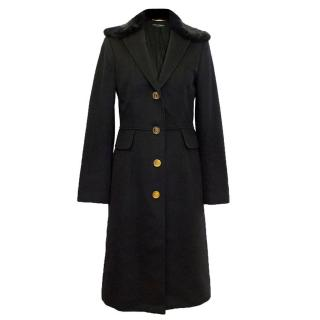 Dolce and Gabbana black fur collared trench coat.