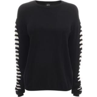 Slash sleeves and cream knit inserts  MCQ Alexander