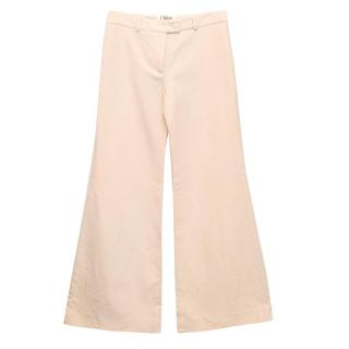 Chloe pale pink flare trousers