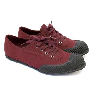 Prada burgundy sneakers.