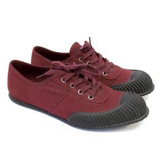 Prada burgundy sneakers.