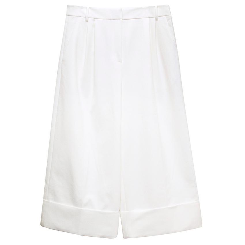 Tibi White stretch pleat trousers.