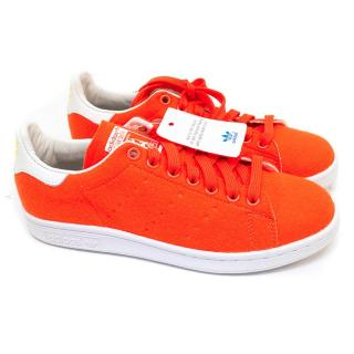 Adidas X Pharell Williams bright orange Stan Smith trainers