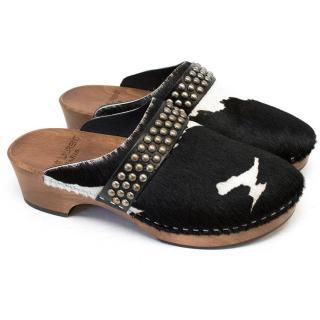 Saint Laurent black and white pony fur clogs