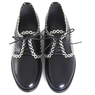 Alaia derby lace ups with metal eyelets