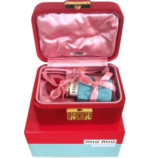 Miu Miu fragrance cocooned in Miu Miu Red Satin Jewellery box. (RPP �542)