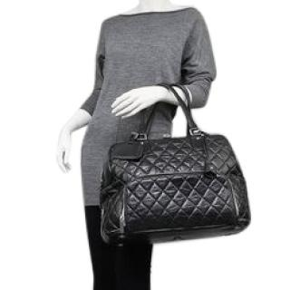 CHANEL Black Quilted  Lambskin Leather Holdall