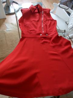 Chanels house designer Karl Lagerfeld presents poppy red biker dress